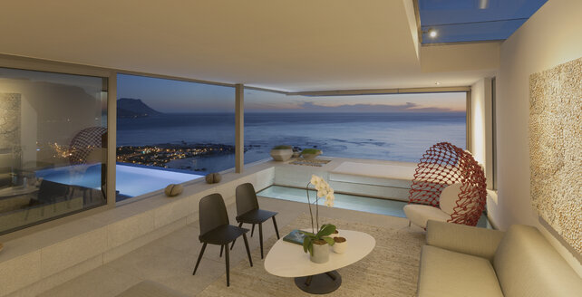 Illuminated modern, luxury home showcase living room and pool with twilight ocean view - HOXF01265
