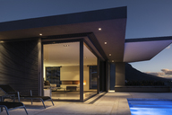Illuminated modern home showcase exterior at night - HOXF01346
