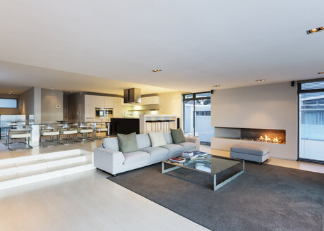Modern luxury home showcase living room with gas fireplace - HOXF01355