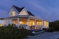 Illuminated white home showcase exterior at night - HOXF01364