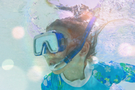 Close up girl snorkeling underwater - HOXF01403