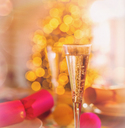 Close up champagne flutes and Christmas crackers - HOXF01883
