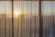Tranquil sunset behind gauze curtains - HOXF01988