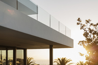 Balcony of modern luxury home showcase exterior at sunset - HOXF02003