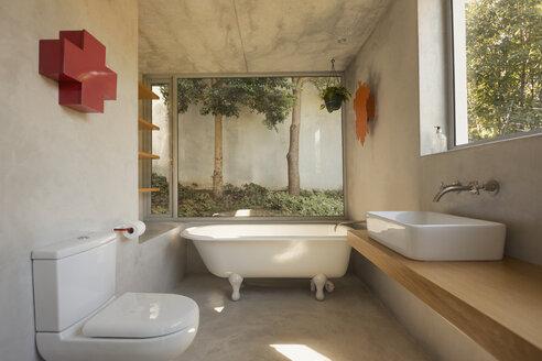 Modern, minimalist luxury bathroom with soaking tub and windows - HOXF02030