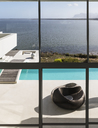 Modern luxury home showcase exterior infinity pool with sunny ocean view - HOXF02105