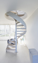White spiral staircase in modern home showcase interior - HOXF02120