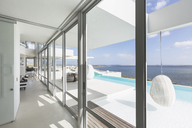 Modern luxury home showcase windows with infinity pool and ocean view - HOXF02144