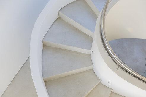 White, concrete spiral staircase in modern home showcase interior - HOXF02147