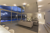 Illuminated modern luxury home showcase interior at night - HOXF02165