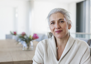 Portrait mature woman sitting at dining table - HOXF02279