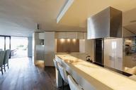 Illuminated, modern, minimalist luxury home showcase interior kitchen - HOXF02396