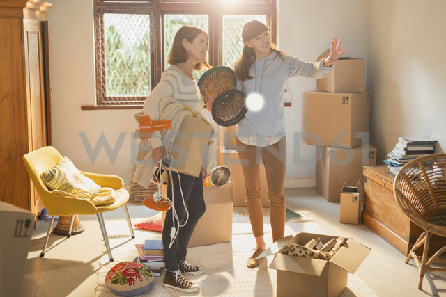 Mother helping young adult daughter moving into new apartment - HOXF02570