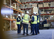Manager and workers meeting in distribution warehouse - HOXF02846