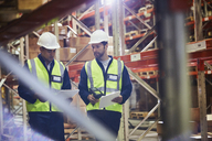 Workers with clipboards and scanner in distribution warehouse - HOXF02894