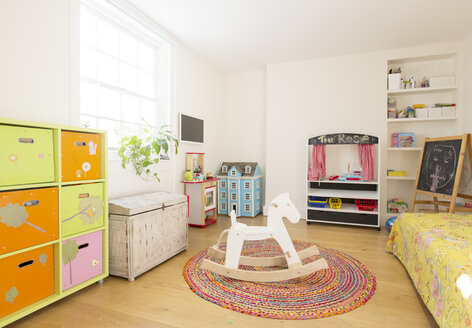 Wooden rocking horse in child's bedroom - HOXF03194