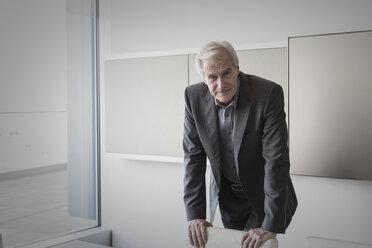 Portrait confident senior businessman in conference room - HOXF03239