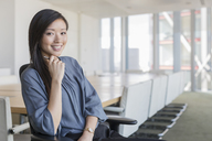 Portrait confident businesswoman in conference room - HOXF03278