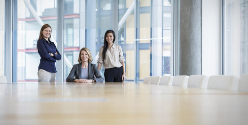 Surface level portrait confident businesswomen in conference room - HOXF03284