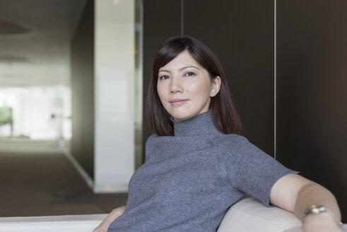 Portrait confident businesswoman on sofa - HOXF03287