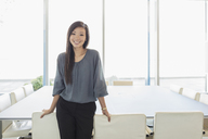 Portrait confident businesswoman in conference room - HOXF03293