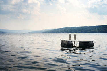 Floating platform on lake against sky - CAVF00668