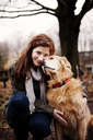 Portrait of beautiful woman stroking Golden Retriever - CAVF00740