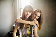 Portrait of smiling female friends at home - CAVF01060