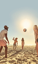 Young friends playing with beach ball on sunny summer beach - CAIF04825