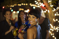 Woman smiling at party - CAIF04853