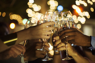 Friends toasting each other at party - CAIF04877