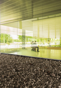 Business people talking in modern office lobby - CAIF05059