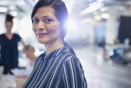 Portrait smiling, confident mature businesswoman - CAIF05674