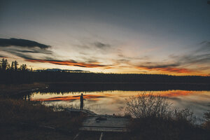 Canada, British Columbia, man fishing at Duhu Lake at sunset - GUSF00487