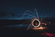 Canada, British Columbia, man light painting at Duhu Lake at night - GUSF00490