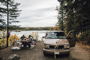 Canada, British Columbia, friends with minivan resting at Boya Lake - GUSF00496