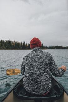 Canada, British Columbia, man in canoe on Boya Lake - GUSF00508