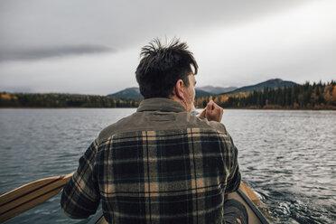 Canada, British Columbia, man in canoe on Boya Lake - GUSF00511