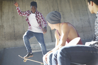 Teenage boys skateboarding at skate park - CAIF05929