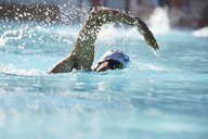 Male swimmer athlete swimming in swimming pool - CAIF05995