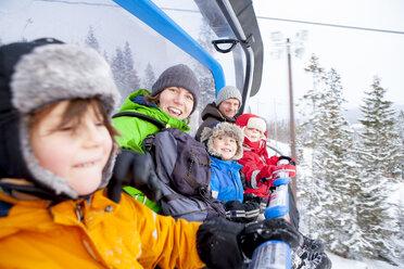 Portrait family riding ski lift - CAIF06019