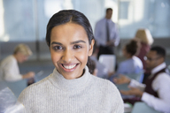 Portrait smiling businesswoman in conference room meeting - CAIF06136