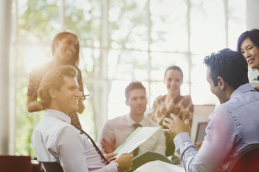 Business people talking in conference room meeting - CAIF06199
