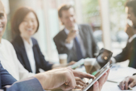 Businessman touching digital tablet in conference room meeting - CAIF06217