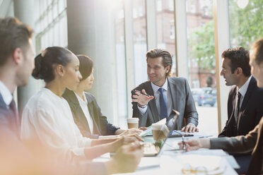Businessman talking, leading conference room meeting - CAIF06262