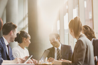 Smiling businessman leading conference room meeting - CAIF06271