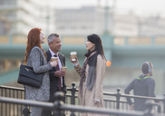 Business people drinking coffee and talking on urban ramp - CAIF06316