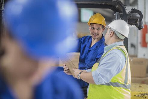 Two men wearing talking in factory - ZEF15115