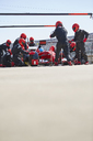 Pit crew replacing tires on formula one race car in pit lane - CAIF06444