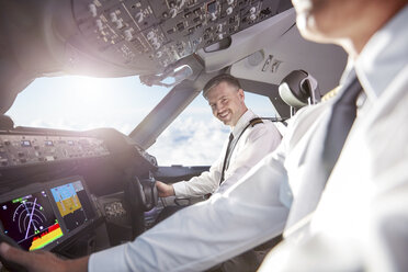 Portrait smiling, confident pilot in airplane cockpit - CAIF06582